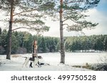 girl with dog in winter forest | Shutterstock . vector #499750528