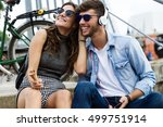 portrait of happy young couple... | Shutterstock . vector #499751914