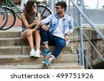 portrait of happy young couple... | Shutterstock . vector #499751926