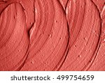 Red moroccan cosmetic clay texture close up. Abstract background
