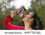 young woman holding a trophy  | Shutterstock . vector #499770700