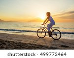 woman on vacation biking at...