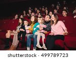 happy family in the movie | Shutterstock . vector #499789723