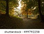 a girl running in a park in... | Shutterstock . vector #499792258