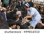 Small photo of BANGKOK, THAILAND - OCTOBER 14,2016 : Nurse distribute Ammonia to crowd
