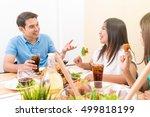 People Enjoying Eating And...