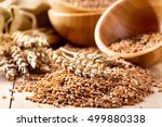 wheat ears and grains on a...