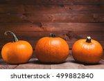 three fresh orange pumpkin on... | Shutterstock . vector #499882840