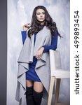 beautiful woman in a blue dress ... | Shutterstock . vector #499893454