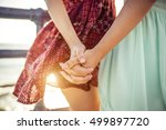 two girls holding each other... | Shutterstock . vector #499897720