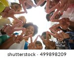 Small photo of education, friendship, gesture, victory and people concept - group of happy international students or friends standing in circle and showing peace or v sign