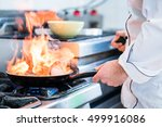 chef doing flambe to dish in... | Shutterstock . vector #499916086