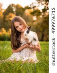 Stock photo happy little child girl with cute rabbit portrait of kid with pet outdoors 499976713