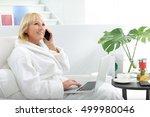 senior lady using modern... | Shutterstock . vector #499980046