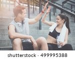 athletic friends giving a high... | Shutterstock . vector #499995388