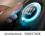 Stock photo hand about to press a button concept of new year two thousand seventeen composite between a 500017438