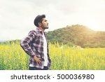 hipster man standing in flower... | Shutterstock . vector #500036980
