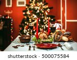 christmas dinner by candlelight ... | Shutterstock . vector #500075584