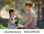happy asian mother cleaning her ... | Shutterstock . vector #500109034