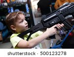 child shooting a rifle in an... | Shutterstock . vector #500123278