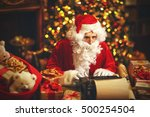 Santa Claus At Desk With...