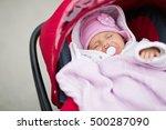 baby sleeping in pram outdoors   Shutterstock . vector #500287090