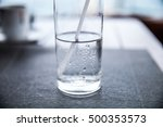 a glass half full with water... | Shutterstock . vector #500353573