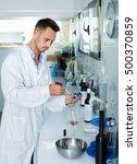 young man in white coat...   Shutterstock . vector #500370859