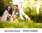 young couple sitting on the... | Shutterstock . vector #500376880