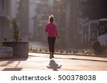 sporty woman running on... | Shutterstock . vector #500378038