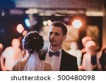 groom looks at the crowd while...   Shutterstock . vector #500480098