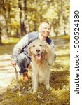 young man walking a dog at the...   Shutterstock . vector #500524180