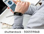 Small photo of Businessman receives access code to bank mobile application on his smartwatch