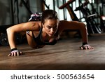 sporty young woman doing a push ... | Shutterstock . vector #500563654