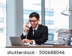 young businessman talking on... | Shutterstock . vector #500688046