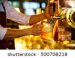 waiter pours beer in a pub | Shutterstock . vector #500708218