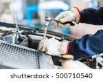 mechanic repairing a car | Shutterstock . vector #500710540