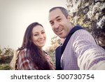 portrait of happy couple taking ... | Shutterstock . vector #500730754