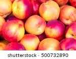 heap of fresh ripe peaches in a ... | Shutterstock . vector #500732890