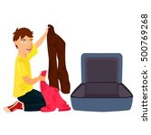 boy packing his clothes in an... | Shutterstock .eps vector #500769268