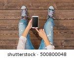 young girl using white smart... | Shutterstock . vector #500800048