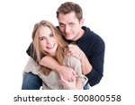 Small photo of Happy couple posing and being playful and affective with each other isolated on white background