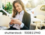 happy businesswoman using phone ... | Shutterstock . vector #500811940