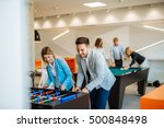 coworkers playing a foosball... | Shutterstock . vector #500848498