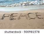 Peace Written In The Sand On...