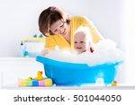 happy baby taking a bath... | Shutterstock . vector #501044050
