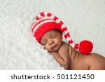 A One Month Old Baby Wearing A...