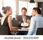 young couple sitting at desk... | Shutterstock . vector #501231409
