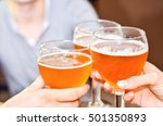three people clink glasses with ...   Shutterstock . vector #501350893