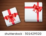 gift boxes on brown wooden... | Shutterstock .eps vector #501429520